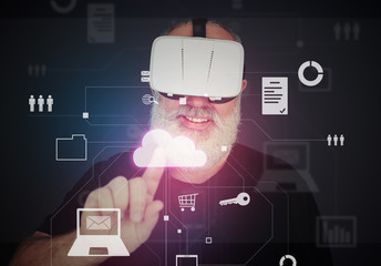 Aged man in virtual reality headset using interactive virtual t