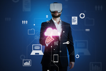 Man in business suit and VR-headset touching a cloud icon on vi