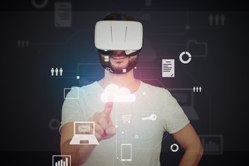 Man in virtual reality glasses using virtual touch screen techn
