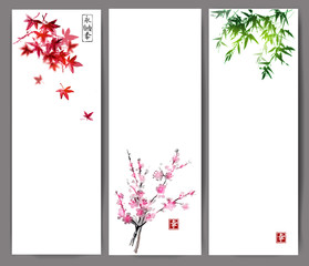 Three banners with maple, bamboo and oriental cherry sakura in blossom. Traditional Japanese ink painting sumi-e on white background. Contains hieroglyphs - eternity, freedom, happiness