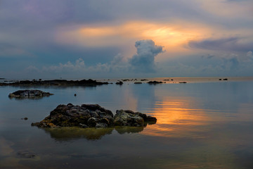 Stones in the sea at beautiful dusk sunrise