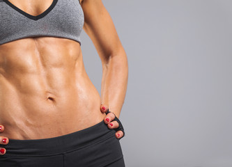 Cropped image of female model with muscular torso