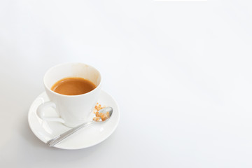 White cup of coffee on white wood table