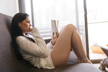 Sexy Woman in Underwear Reading a Book at Home