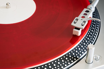 Red vinyl record on the player