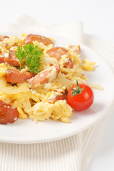 scrambled eggs with sliced sausage