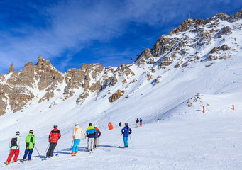 Skiers on the slopes of the ski resort of Meribel, France