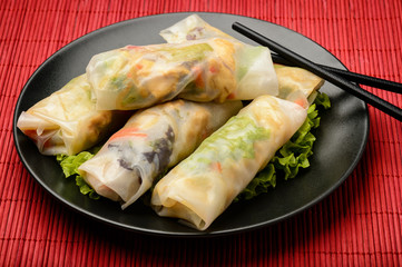 Spring rolls with vegetables and chicken - traditional vietnamese cuisine.