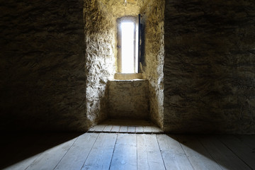 Dark room with stone walls window