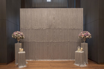 backdrop flowers with white and silver fabric arrangement ready for wedding ceremony