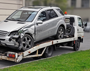 Fragment of tow truck which is taking away  faulty car