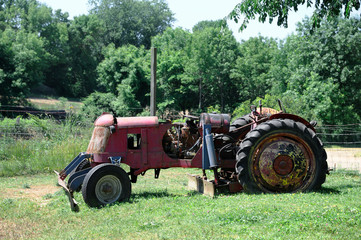 abandoned old tractor in the farm