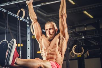 Male doing exercises on horizontal bar.