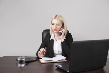 woman businessman on workplace in office talking on the phone