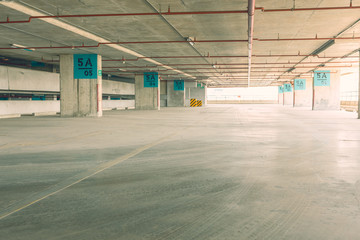 Empty car building for interior design background with vintage tone.