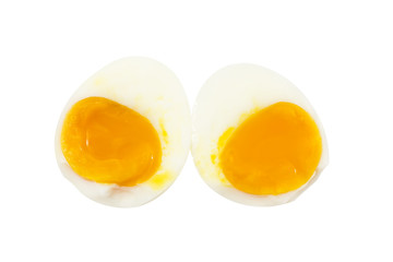 Boiled egg half slice with smooth egg york on top view