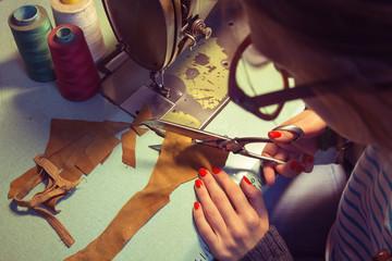 Tailor in her retro shop.