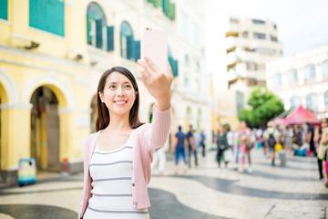 Young woman take self image in Macau