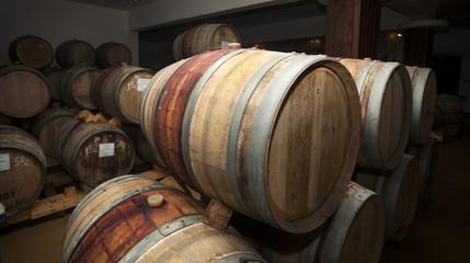 Wine barrels in cellar.
