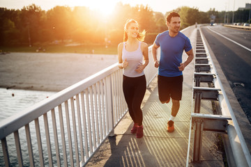 Active couple jogging Wall mural