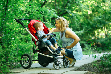 Pregnant woman with her child in pram