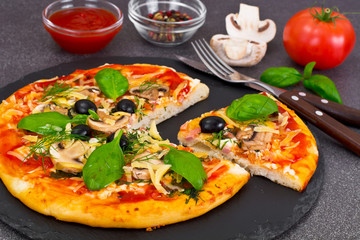 Pizza with Mushroom, Cheese, Mozzarella, Olives and Basil