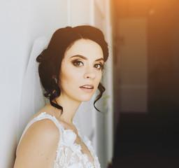 Bride posing in a corridor