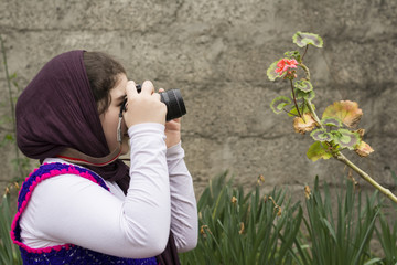 Young Little Girl Is Taking Photograph by an Analogue Camera Str