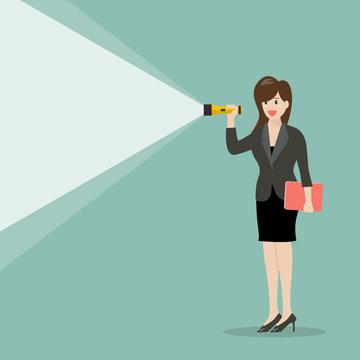 Business woman holding flashlight