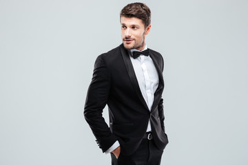 Attractive young man in tuxedo and bowtie