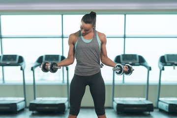 Healthy Young Woman Doing Exercise For Biceps