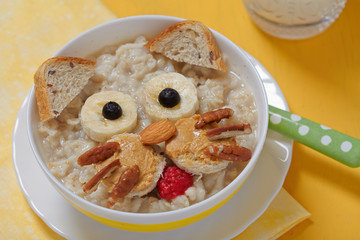 Funny oatmeal with cat face decoration