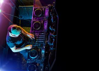 Disc jockey mixing electronic music in club