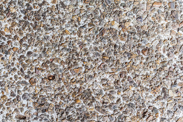 Wall of small sand stone texture background