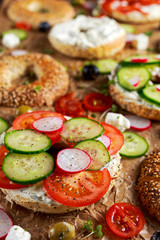 Delicious Bagel sandwiches with soft cheese, chorizo, vegetables. selected focus