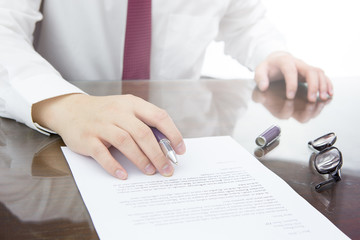 Businessman is signing a contract, business contract details. Or businessman signing on a resignation letter concept.