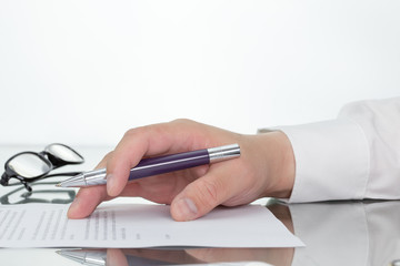 Close up of a businessman reading a business report. or businessman is reading and checking contract.