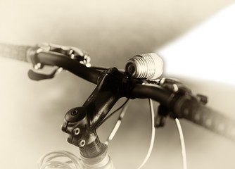 Horizontal sepia bicycle flashlight  bokeh background
