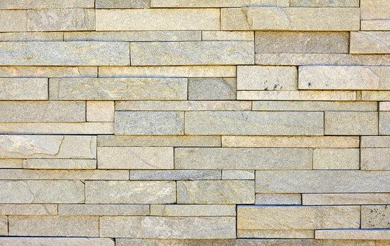 Stone veneer white mineralized granite rock wall