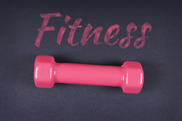 Fitness. Fitness is written with chalk on a black background.