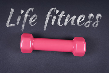 Life Fitness. Life Fitness is written with chalk on a dark background.