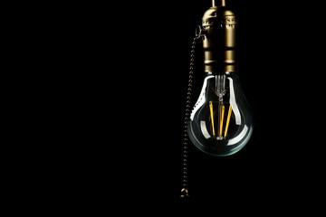 Light bulb on black background, close up