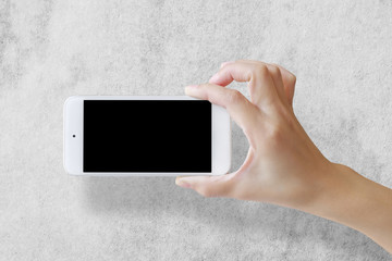 Selfie with mobile smart phone on grey concrete background