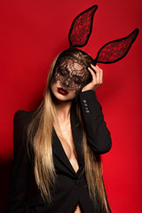 Hot and sexy fashion portrait of a seductive girl posing in a lace like bunny