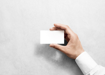 Hand holding blank white business card design mockup. Clear calling card mock up template holding arm. Visit pasteboard paper surface display front. Standart offset card print. Business card branding