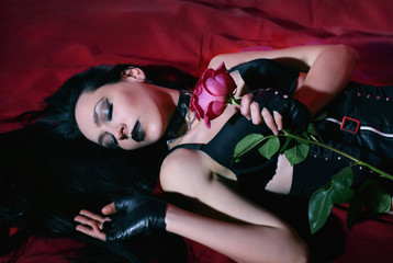 beautiful gothic girl sleeping with a rose
