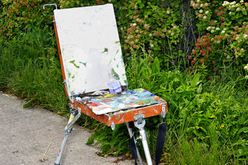 Outdoor easel with paints and paint a picture mounted on the par