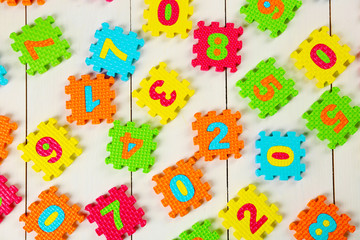 Colorful  puzzle mat on wooden background