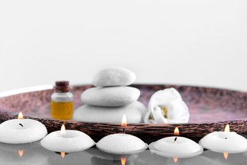 Spa composition with candles, close up