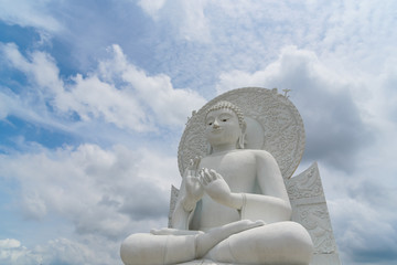 "White Buddha statue - The attitude of giving the first sermon in ""Sangdhamsongchevit"" Spiritual Center at Saraburi, Thailand."